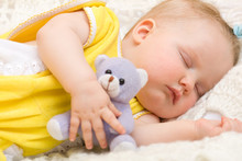 Baby Sleeping With Her Bear Toy