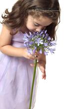 Girl Smelling A Beutiful Flower