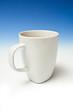 A white china mug of tea.