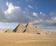 Leinwandbild Motiv Pyramids under blue sky