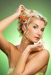 Beautiful young woman with fresh spring flowers in her hair. Spr