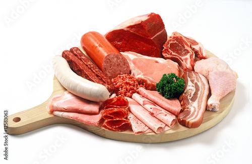 Fotografie, Obraz  Holzteller mit Fleisch und Wurst/plate with meats and sausage
