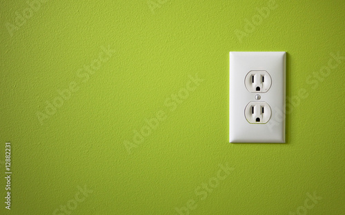 Fotografiet white electric outlet mounted on green wall