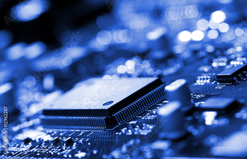 Fototapeta  microchip on blue circuit board