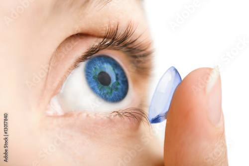 Fotografía  beautiful human eye and contact lens isolated