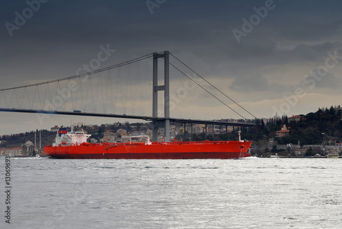 Photo  ship under Bosphorus bridge before the storm