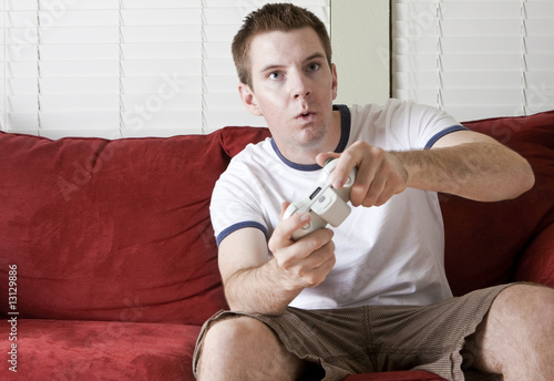 Fotografering  Gamer on the couch