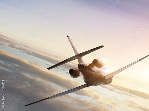 Jet plane at fly to the sunset Canvas Print