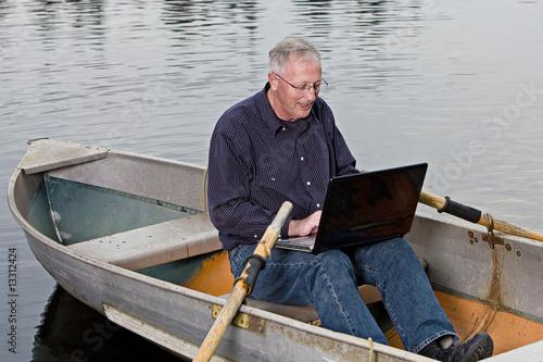 Fotografie, Obraz  Mature Man working on computer outside