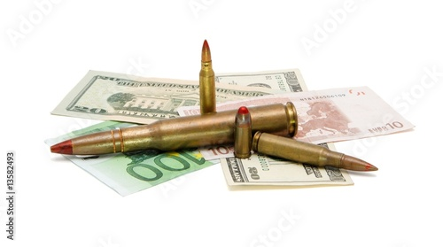 Money and cartridges on whi...