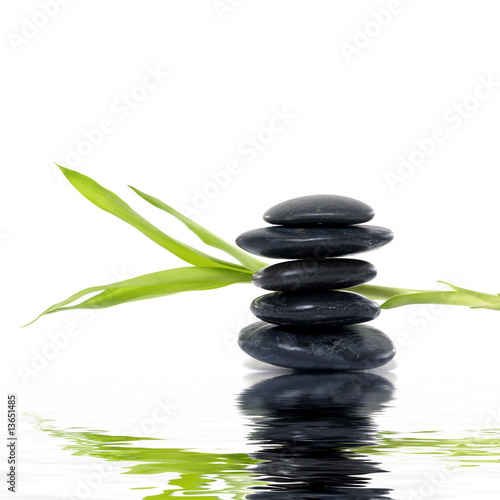 Spoed Foto op Canvas Zen stack black stones with bamboo leaf with reflection