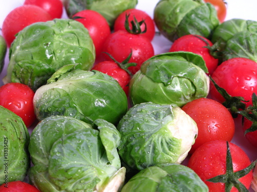 Tuinposter Groenten Brussels sprouts and cherry tomatoes, on white background