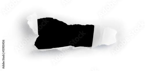 Fotografía  image d'un trou dans une feuille de papier pour message
