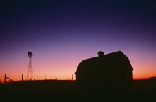 Silhouette Of Barn And Windmill