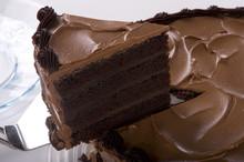 Chocolate Cake Being Sliced