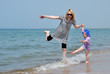 Happy mother and child on the sea beach