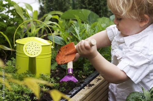 Tela toddler gardening