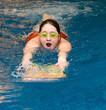 girl swiming in the swimming pool