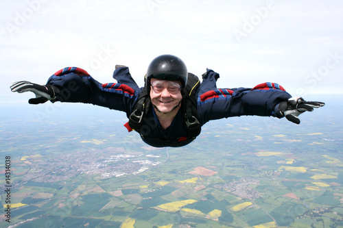 Fotografie, Obraz  Close up of a skydiver in freefall