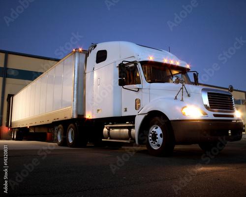 Canvastavla Semi Truck / Tractor Trailer at dock night view