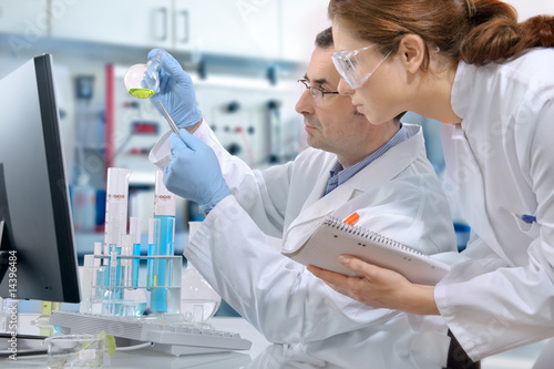 scientists working at the laboratory Poster