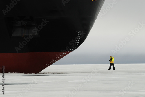Papiers peints Arctique Person at bow of icebreaker, Franz Josef Land, Russia
