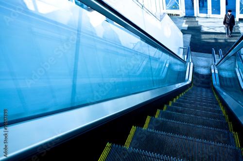 Fototapeta on the top of gray escalator in new trade center obraz na płótnie
