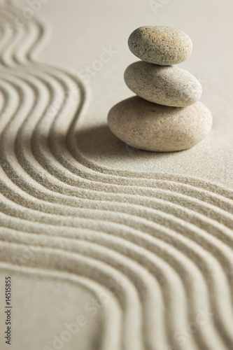Acrylic Prints Stones in Sand Stack of stones on raked sand