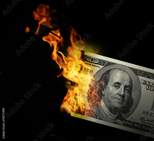 Fotografie, Obraz  Burning dollars close up over black background