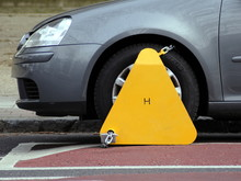 Car Wheel Clamped On Road