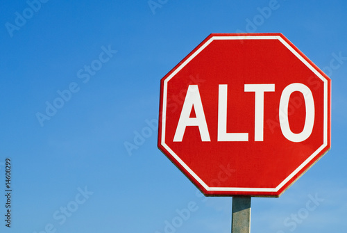Stop road sign in Mexico, with the words Alto Canvas Print