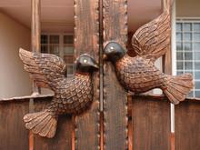 Pigeons Statue On Metal Door