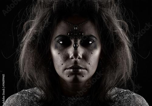Fotografía Portrait of witch over dark background