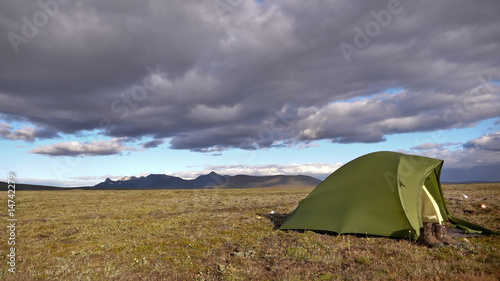 a Tent in front of a Thunderstorm in Iceland - Buy this