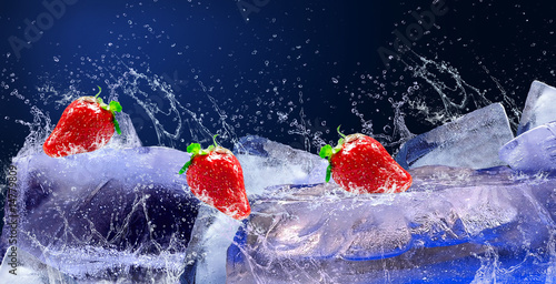 Water drops around red strawberry on the ice - 14779809