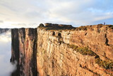 Fototapeta Góry - Sheer cliffs of Mount Roraima - landscape with clouds background