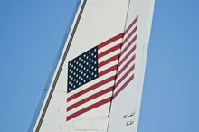 American Flag On Tail Of Airpl...