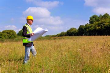 Architect surveying a new building plot