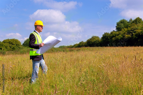 Architect surveying a new building plot Fototapeta