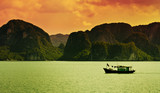 A boat sailing along the coast of Halong Bay, Vietnam