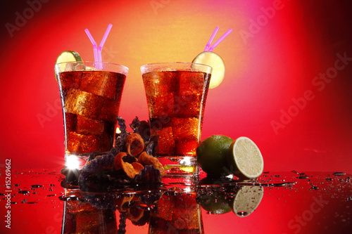 Fotografie, Obraz  Rum and cola - Cuba Libre - with exotic chips