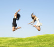 two jumping woman