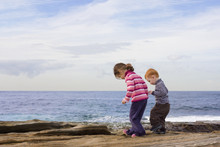 Kids Stepping In Rockpools