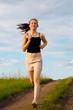 woman run on green grass