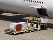 Loading and unloading cargo onto an airplane