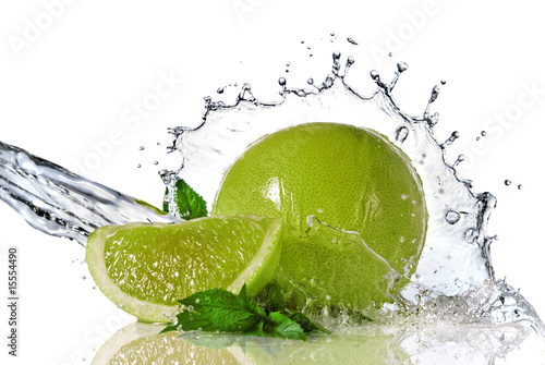Foto op Canvas Opspattend water Water splash on lime with mint isolated on white