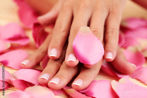 Poster Pedicure hand with rose petals