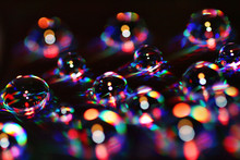 Water Drops Over A DVD Become Colorful Bubbles