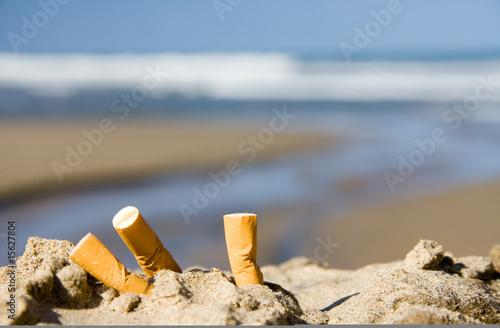 Vászonkép  three cigarettes on beach