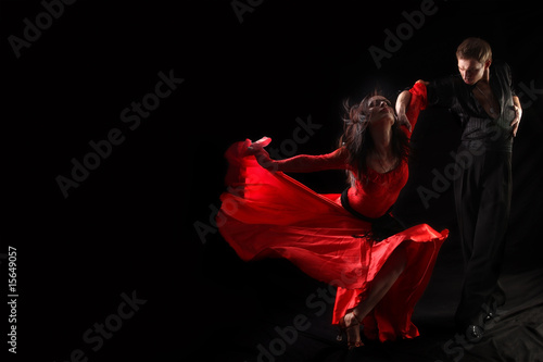 dancer in action against black background